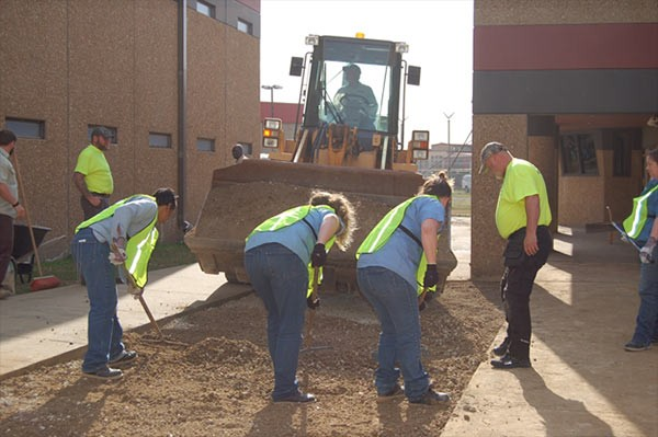 Female Inmates Installing Flexi-Pave